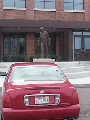 George's Cadillac parked defiantly at Bo Schembeckler's statue